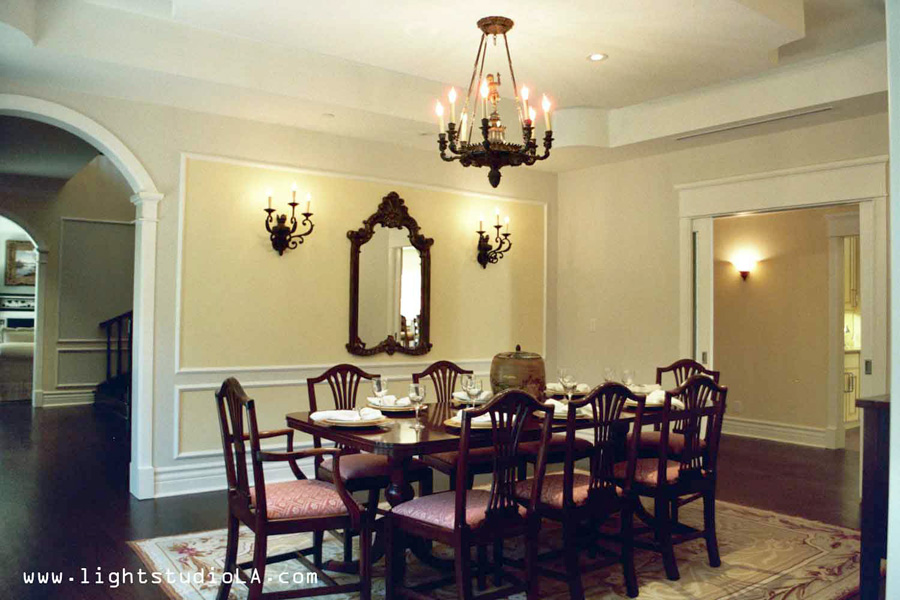 Chandelier With Matching Wall Sconces In The Dining Room